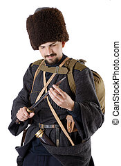 Russian Cossack inspecting a poniard. The living history. -...