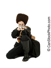 Russian Cossack points a rifle at camera in squatting...
