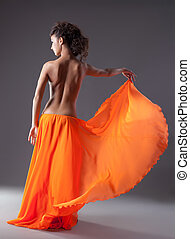 woman dance in orange veil with naked spine - beauty woman...