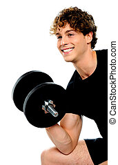 Muscular man in black sportswear with dumbbell looking away