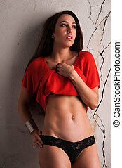 Brunette - Beautiful young brunette against a cracked...