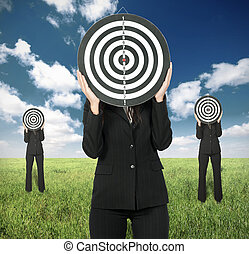 Business competition concept with businesswoman and darts...