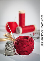 Red sewing kit - Still life with sewing theme in red,...