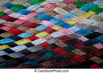 Braid of colourful threads - A braid of colourful sewing...