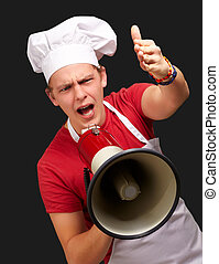 portrait of young cook man screaming with megaphone and...