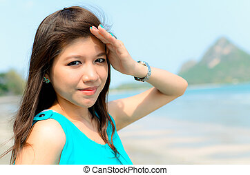 Attractiv ASian woman hold hand protect her face from sun...