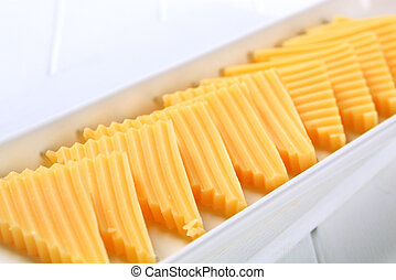 Hard cheese cut into triangles