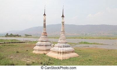 Boat at Takhaung Mwetaw Paya pagoda - Inle lake, Myanmar