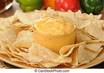 Tortilla chips with spicy cheese dip - A platter of tortilla...
