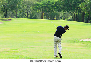 Golfer hitting a driver from the tee-box - Golfer hitting a...