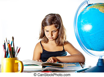 Back to school: finishing summer homework - Little girl...