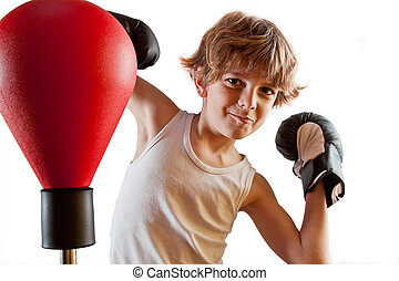 Boxer kid training with punching ball - Kid with attitude...