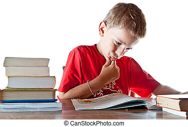 Back to school: a little boy and his homework - A little boy...