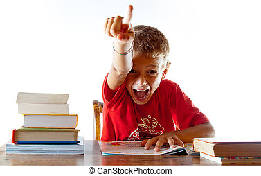 Back to school: a little boy getting his homework right - A...