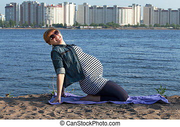 Pregnant woman doing gymnastic exercises