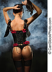Brunette dressed up in black corset - Back of alluring...
