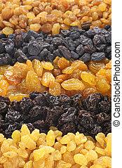 Assorted raisins - Heap of assorted raisins close-up.