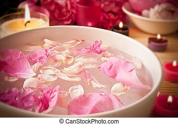 Aromatherapy oils, flower petals, candles - An arometherapy...