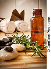 Aromatherapy oil and herbs - A bottle of aromatherapy oil...