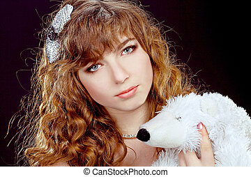 Portrait of the beautiful girl with red long ringlets hair isolated on black background