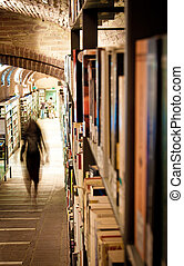 People in library aisle - People moving about in a library...