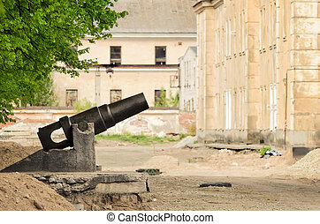 like after war - an old cannon in abandoned city