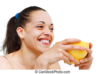 Cute young woman having her breakfast and smiling to the life