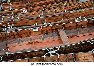 wooden rowing boats with ornate metal detail