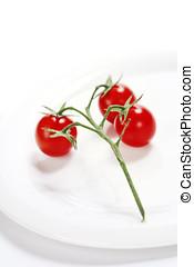 cherry tomatoes - bunch of fresh cherry tomatoes on white...