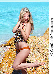 Happy young woman on beach and sea