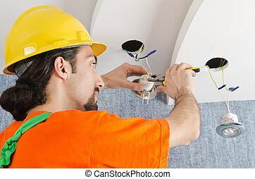 Electrician repairman working on refurbishment