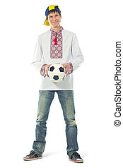 Ukrainian man in the national shirt with a ball
