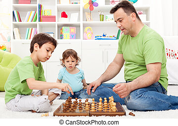 Whoa - that is awsome, toddler boy looking at chess game