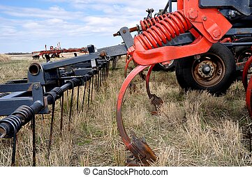 Farm Cultivator - Close look at a farm cultivator, sitting...