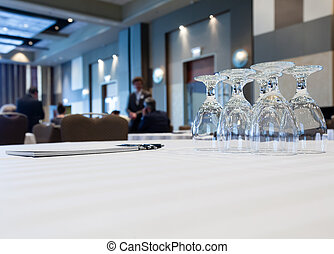 Conference room with tables with people - Conference table...