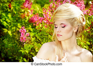 Emotional Girl with blond hair style on the nature. Pink makeup