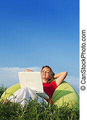 Woman relaxing outdoors - large copyspace