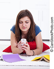 Teenager texting instead of learning