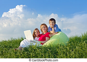 Woman with kids hanging out relaxing outdoors