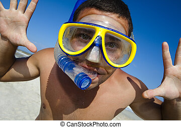 Funny diving man in a swimming mask and snorkel