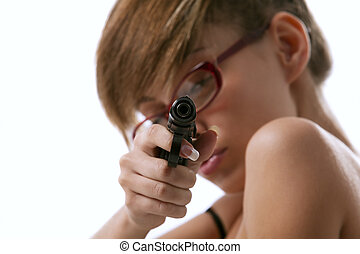 Woman in red glasses taking aim from a gun - The pretty...