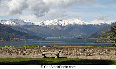 bench with fantastic view of Lake Como and Alps seen from Gardens of Villa Serbelloni in Bellagio, Lombardy, Italy, Europe