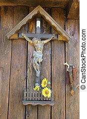 jesus on the cross and sunflowers - wooden jesus on the...