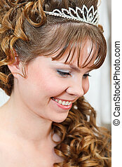 Beauty young Caucasian woman with curly hair and crown on nead