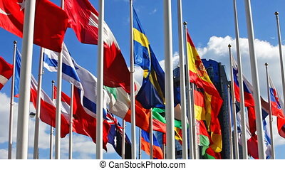 Flags on a background of the blue s - Flags of the different...
