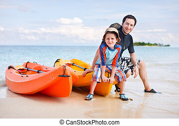 Father and son after kayaking - Happy father and son after...