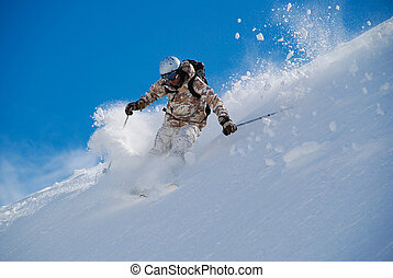 Skier in bright clothing, in deep snow