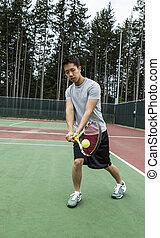 Outdoor Door Tennis - Backhand Stroke - Young man hitting...