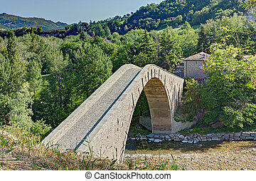 humpback bridge - ancient humpback bridge in Castel del Rio,...