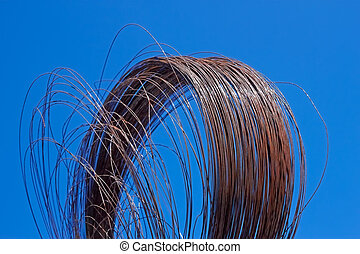 Rusty wire against blue sky - Roll of the old rusty iron...